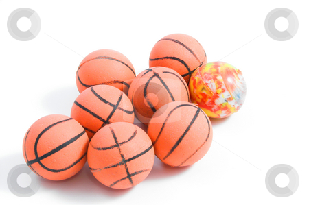 Bouncy Balls stock photo, Bouncy Balls shaped like basketballs except for that one. by Robert Byron