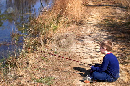 Fisherman stock photo, A litlle boy fishing in a pond. by Robert Byron