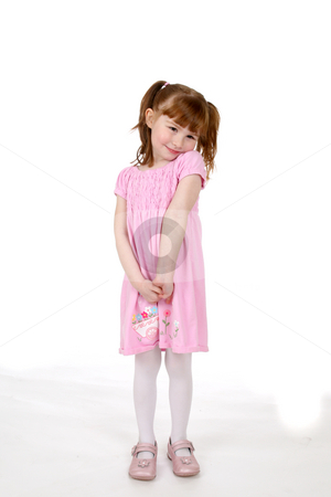 Cute girl in pink dress stock photo, Cute girl in pink dress shrugging her shoulders by Sue and Shawn Roberts