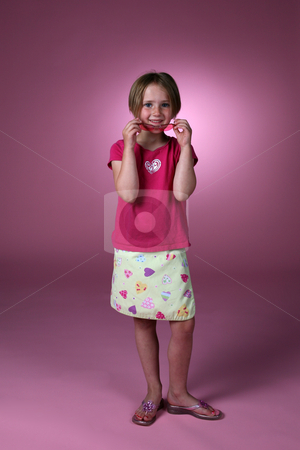 Cute girl in pinks stock photo, Cute girl removing sunglasses and smiling by Sue and Shawn Roberts
