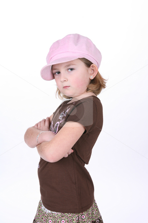 Cute girl with hat stock photo, Cute girl with her arms crossed and pouting against a high key background. by Sue and Shawn Roberts