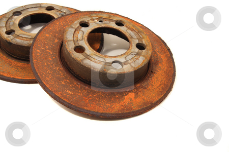 Rotors stock photo, Rusty used brake rotors on white by Jack Schiffer
