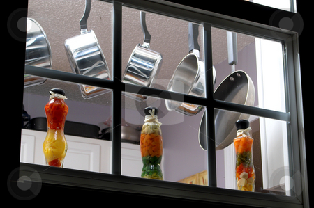Kitchen Window stock photo, Pots and pans hanging in a kitchen window. by Robert Byron
