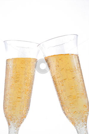 Champagne stock photo, Bubbling champagne in a crystal champagne flute. by Robert Byron