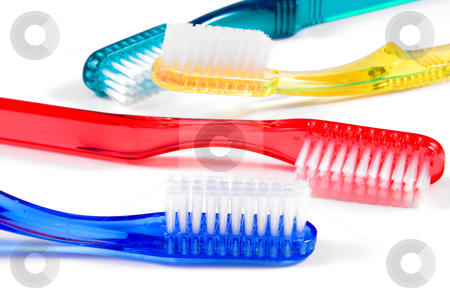 Toothbrushes stock photo, A series of colorful toothbrushes used for dental hygiene. by Robert Byron