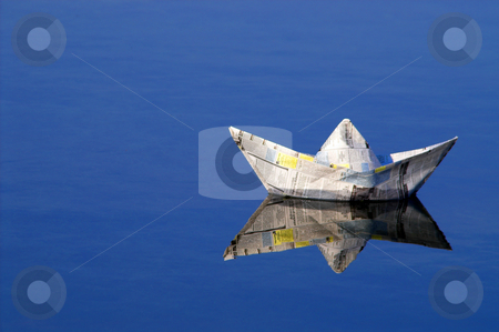 Paper Boat stock photo, A paper boat sailing on the high seas. by Robert Byron