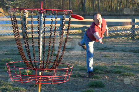Disc Golfer stock photo, A man playing a competitive round of disc golf. by Robert Byron