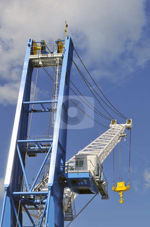 Crane stock photo, Big crane with yellow hook against a blue sky by Massimiliano Leban