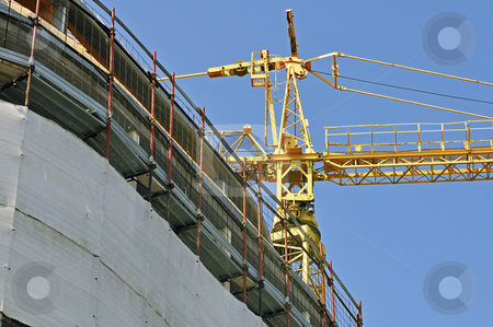 Building under construction - horizontal stock photo, View of a new building with a yellow crane by Massimiliano Leban