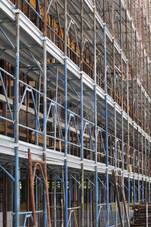 Scaffolding  stock photo, Long and tall scaffold in a construction site by Massimiliano Leban