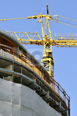 Building under construction - vertical stock photo, View of a new building with a yellow crane by Massimiliano Leban