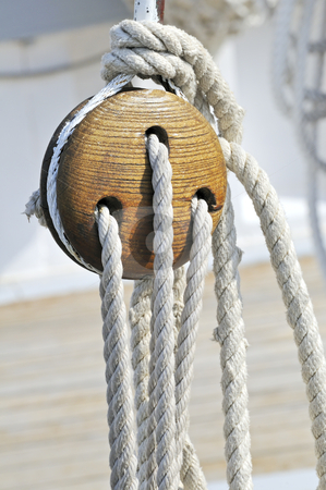Sailboat detail stock photo, Close-up of a vintage boat: wooden block and ropes by Massimiliano Leban