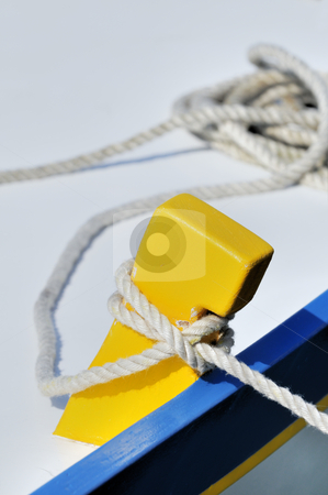 Moored boat stock photo, Close-up of a tied-up rope securing boat to dock by Massimiliano Leban
