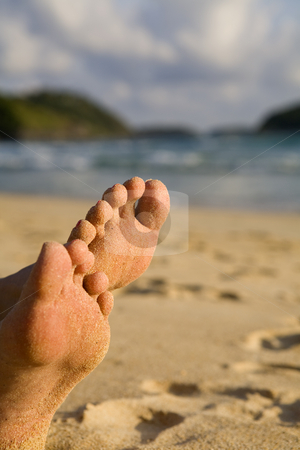 Sandy feet on beach stock photo, Sandy feet on beach by Magdalena Ascough