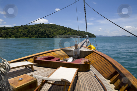 Deck of yacht  stock photo, Front deck of yacht with chairs sailing in the ocean by Magdalena Ascough