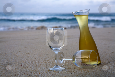 White wine on beach stock photo, White wine in carvatte and glasses on beach by Magdalena Ascough