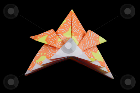 Origami Samurai Hat stock photo, An origami samurai hat made of yellow and orange paper on a black background. by Steve Stedman