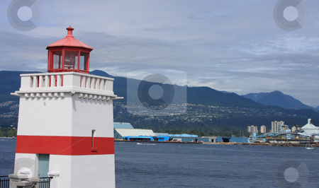 Harbor Lighthouse stock photo, Red and white lighthouse on Vancouver harbor in British Columbia Canada. by Steve Stedman