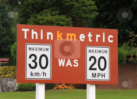 Think Metric stock photo, Thinkmetric sign at a US / Canada border crossing. by Steve Stedman