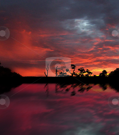 Firey Sunset stock photo, The reflection of a fire sunset over a lake by Sam Sapp