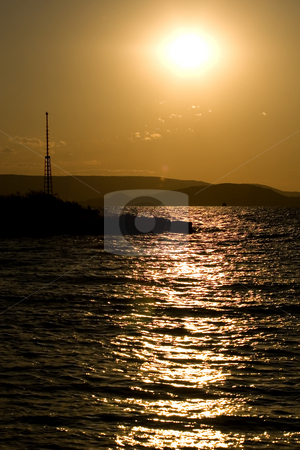 Sunset stock photo, Balaton, calm, clouds, evening, freetime, hills, hungary, lake, lighthouse, mole, nautic, navigation, people, portside, quiet, reflection, relax, sea, starboard, sunset, tourist, travel, walking, water, waves, wind, windy by Fesus Robert