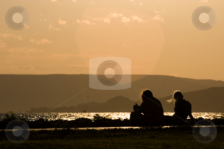 Couple at sunset stock photo,  by Fesus Robert