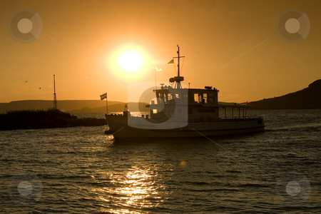 Boat at sunset stock photo, Balaton, calm, clouds, evening, freetime, hills, hungary, lake, lighthouse, mole, nautic, navigation, people, portside, quiet, reflection, relax, sea, starboard, sunset, tourist, travel, walking, water, waves, wind, windy by Fesus Robert