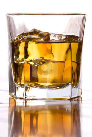 Whiskey on the rocks stock photo, A glass of whiskey on the rocks by Vince Clements