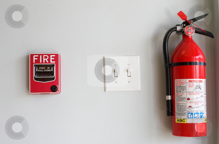 Fire Extiguisher and Alarm Pull Box stock photo, A fire alarm pull box and an extinguisher. by Robert Byron
