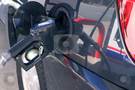 Gas Pump stock photo, A car being filled with gas at a service station. by Robert Byron