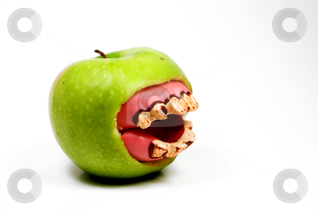 Bad Apple stock photo, Apple with rotting teeth by Robert Byron