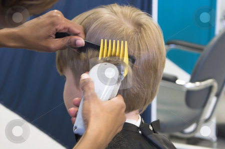 Haircut stock photo, A young boy reluctantly getting his hair cut. by Robert Byron