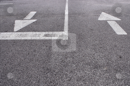 Directional Arrows stock photo, The direction arrows on the pavement of a parking lot. by Robert Byron
