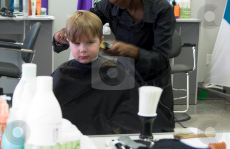 Boy Getting Haircut stock photo, A young boy reluctantly getting his haircut. by Robert Byron