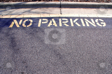 No Parking stock photo, The words No Parking written on pavement. by Robert Byron