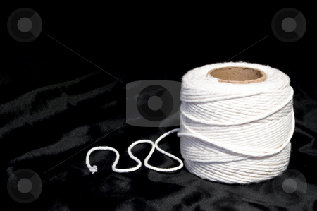 String stock photo, String wound on a spool of cardboard. by Robert Byron
