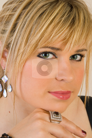 Beautiful young blond woman stock photo, Portrait of a beautiful young blond woman wearing make-up and costume jewelry by Magdalena Ascough