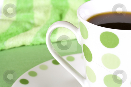 Coffee in green dotted mug stock photo, Freshly brewed coffee in green dotted mug with green background by Magdalena Ascough