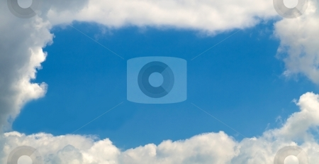 Clouds frame stock photo, Sky with a nice frame of clouds with large copy space by Laurent Dambies