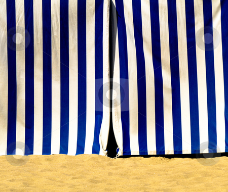 Blue and white striped tent entrance stock photo, Blue and white tent entrance on the beach by Laurent Dambies