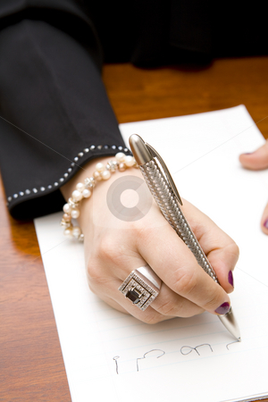 Woman writing note in Arabic stock photo, Closeup of a styleful woman writing a note in Arabic by Magdalena Ascough