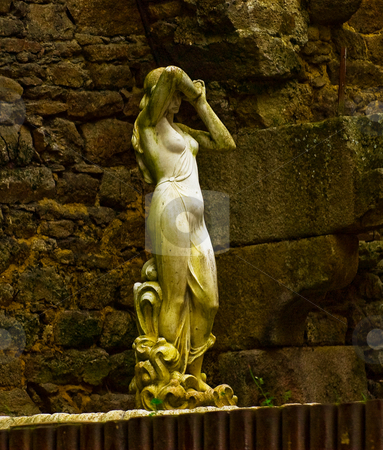STONE WOMAN OF DINAN stock photo, Sculpture as seen from street level in Dinan France, old town section. by Elf Evans