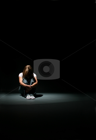 Alone stock photo, Woman sitting with her knees up and head down. by Sue and Shawn Roberts