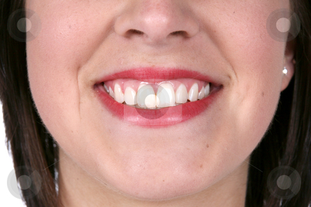 Close up of a pretty smile and great skin stock photo, Close up of a pretty smile and great skin by Sue and Shawn Roberts