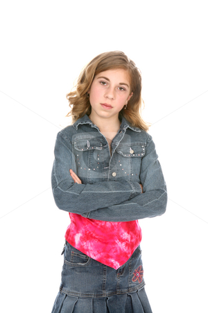 Attitude Tween stock photo, Young girl dressed in denim, standing with her arms crossed and a defiant look on her face. by Sue and Shawn Roberts