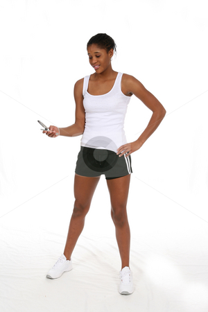 Black teen looking at cell phone stock photo, Pretty African American  teenage girl looking at her cell phone and wearing workout clothes by Sue and Shawn Roberts