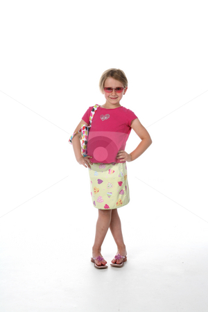 Stylish little girl in sunglasses stock photo, Cute girl in sunglasses, pink shirt and patterned skirt, looking like she's ready for a night on the town! by Sue and Shawn Roberts