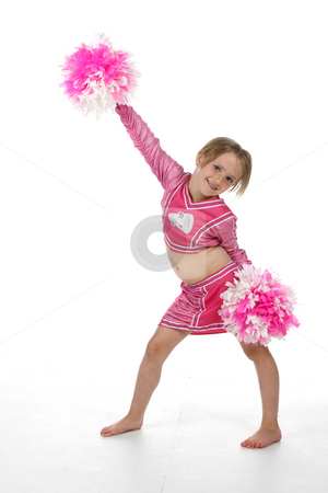 Cute cheerleading girl in pink stock photo, Cute girl in pink cheerleader outfit holding pompoms with one arm up in the air by Sue and Shawn Roberts