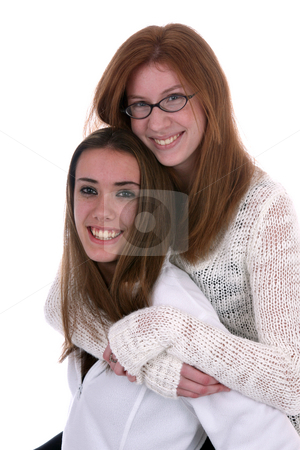 Two teenager friends stock photo, Two young women in white sweaters smiling against a high key background by Sue and Shawn Roberts