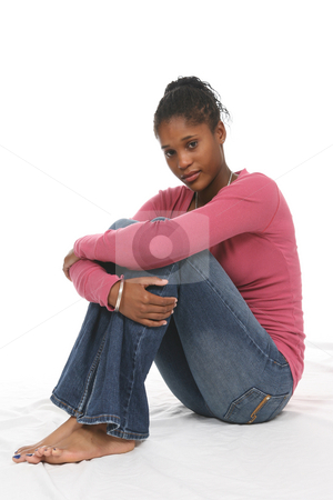 Teen in Pink and Denim stock photo, High Key portrait of a pretty teenage girl sitting with her arms around her knees. by Sue and Shawn Roberts
